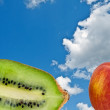 Apple and kiwi on a background sky — Stock Photo