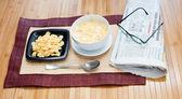 Breakfast and newspaper — Stock Photo