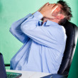 Frustrated businessman in his office — Stock Photo