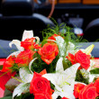 Flower's bouquet on a red car — Stock Photo #6660090