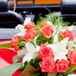 Flower's bouquet on a red car — Stock Photo #6661614