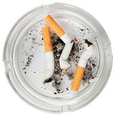 Glass ashtray with stubs — Stock Photo