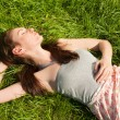 Beautiful girl on grass — Stock Photo