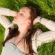 Stock Photo: Beautiful girl on grass
