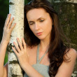 Sad beautiful girl in a birch grove - Stock Photo