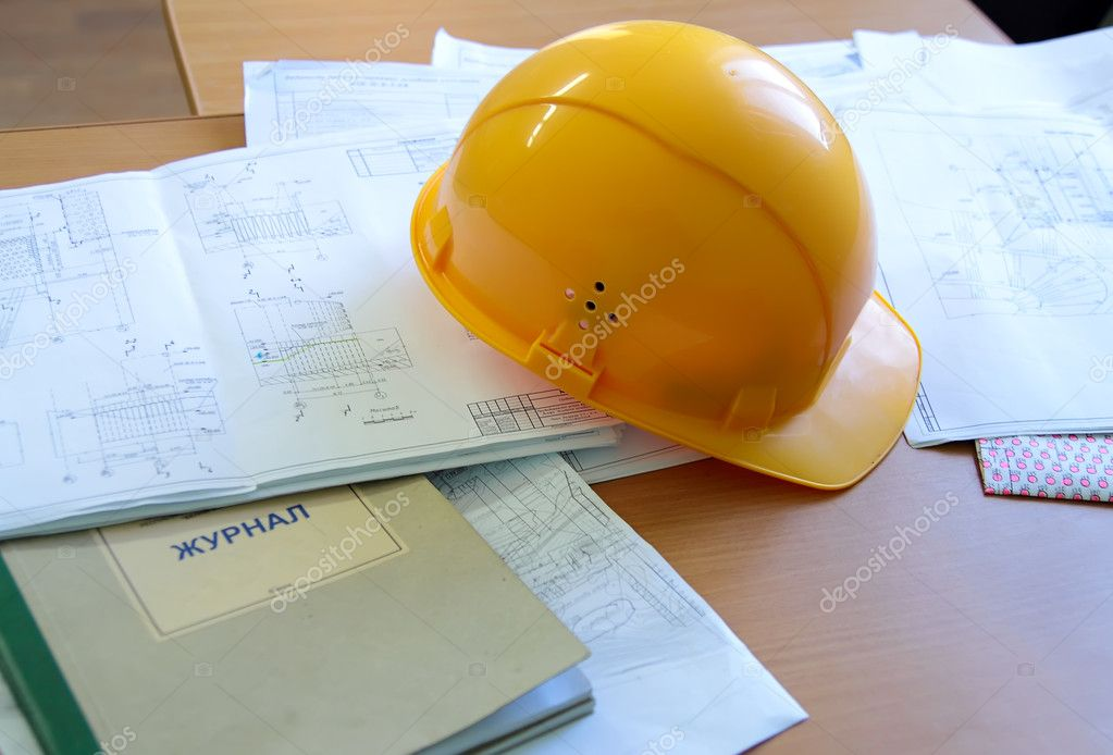 Building a helmet lying on the construction drawings — Stock Photo #5481667