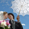 Foto Stock: Blonde bride and groom