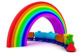 Train under rainbow — Stock Photo