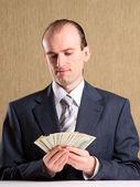 Businessman with money — Foto de Stock