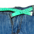 Measuring tape around trousers — Stock Photo