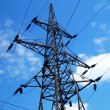 Foto Stock: High voltage tower on blue sky