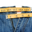 Jeans and tape measure isolated — Stock Photo