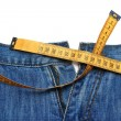 Jeans and tape measure — Stock Photo