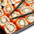 Big colorful sushi set and chopsticks - Stock Photo