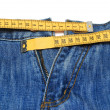 Jeans and tape measure — Stock Photo #5810874