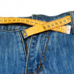 Measuring tape around trousers — Stock Photo #5810917