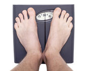 Men on bathroom scale — Foto Stock
