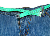 Measuring tape around trousers — Stock Photo