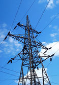 High voltage tower on blue sky — Foto de Stock