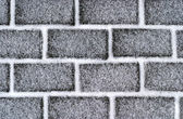 Brickroad with snow — Stock Photo