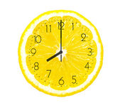 Lemon slice like clock — Stock Photo