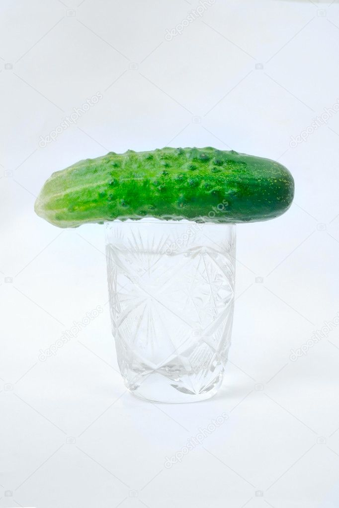 Vodka and cucumber isolated on white — Stock Photo #5810252