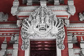 Terrible monster on balinese house entrance — Stock Photo
