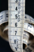 Tape measure on a black background — Stock Photo