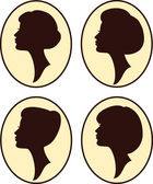 Vector beautiful women and girl silhouettes with different hairs — Stock Vector