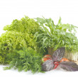 Fresh raw herbs and vegetables - Stock Photo
