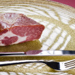 Raw meat on a plate — Stock Photo