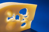 Cheese food close-up on a blue background. — Stock Photo
