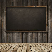 Blackboard in wooden interior — Stock Photo