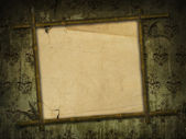Bamboo frame with ancient paper — Stock Photo