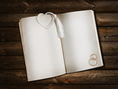 Open book with heart bookmark — Stock Photo