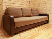 Sofa in wooden interior — Stock Photo