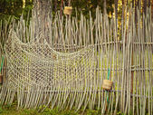 Fence with fishing net — Stock Photo