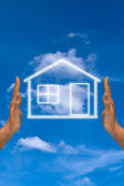 House on sky background — Stock Photo