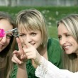 Girls inflating soap-bubbles in the park — Stock Photo #5821716
