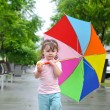 Girl with colorful umbrella — Stock Photo #5821791