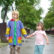 Boy and little girl under the rain — Stock Photo
