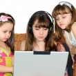 Three little girl in headphones with laptop — Stock Photo #6091328