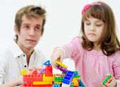 Little girl playing with father — Stock Photo