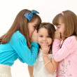 Stock Photo: Sisters sharing a surprising secret
