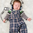 Stock Photo: Newborn kid listening music