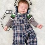 Newborn kid listening music — Stock Photo