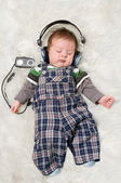 Newborn kid listening music — Stock Photo