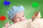 Bébé jouant avec de la peinture — Photo