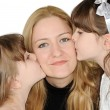Sisters kissing their mother — Stock Photo