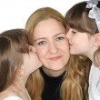 Adorable girls kissing their mother — Stock Photo